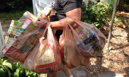 House husband carrying a lot of groceries in one trip.