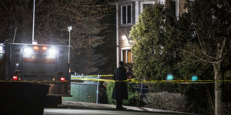 An Orthodox Jewish man stands in front of a residence in Monsey, N.Y., Sunday, Dec. 29, 2019, following a stabbing late Saturday during a Hanukkah celebration. A man attacked the celebration at the rabbi's home north of New York City late Saturday, stabbing and wounding several people before fleeing in a vehicle, police said. (AP Photo/Allyse Pulliam)