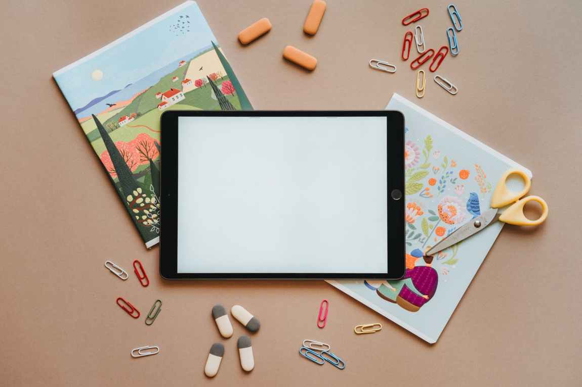 ipad paper clips and erasers flatlay