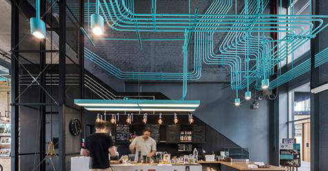 Turquoise Electrical Conduit Is A Design Feature Running Through This Office Space