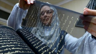 Artist Spends 3 Years Hand-Painting the Quran in Gold on 164 Feet of Black Silk
