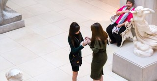 Look at how happy an older woman is when she sees a woman proposing to her girlfriend