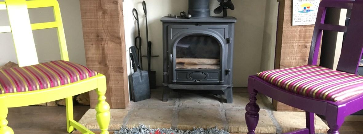 log burner and railway sleeper mantelpiece