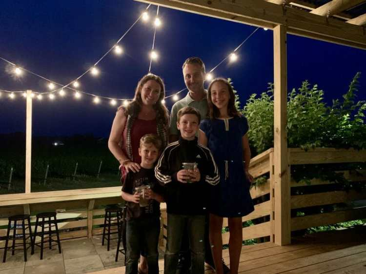 A family at Corey Creek Tap Room on Long Island