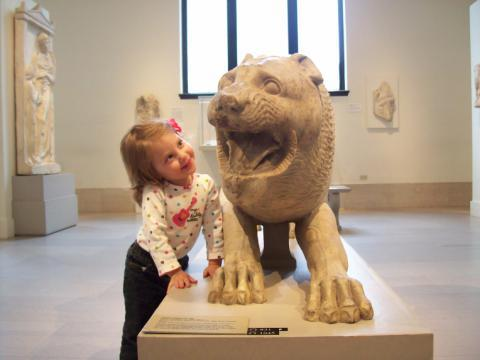 The Mint Chip Mama - A little girl at The Met with a marble lion inManhattan