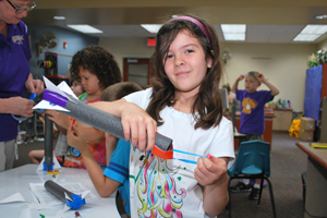 Eight-year-old Krissy Adair builds a rocket during week one of Maumee Summer Camp, a four-week program that features hands-on educational activities and literacy programming.