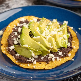 Avocado Tostadas #avocado #tostada #refriedbean #blackbean #cheese #cotija #easyrecipe #lunch #mexicanrecipe #salvadoranrecipe | The Missing Lokness
