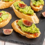 Fig and Brie Avocado Toasts | These little toasts make great lunches! Lightly toasted baguette spread w/ brie & fig jam, then top w/ mashed avocado, fresh fig & flaky sea salt. Quick & easy! #fig #brie #avocado #toast #avocadotoast #crostini #lunch #easyrecipe #appetizer #appetizerrecipe | The Missing Lokness