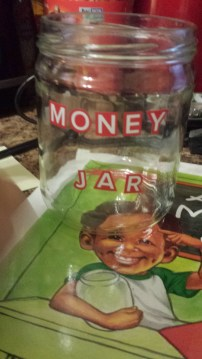 Book Review of Ayo's Money Jar written by Charlene Hill Fadirepo and illustrated by Aniekan Udofia
