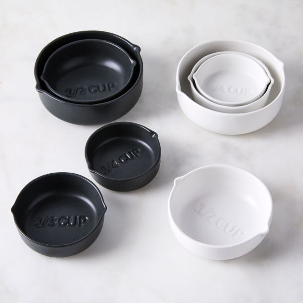ed348afd-44e3-40e0-81c1-ae75ac56eec1--2018-0925_behome_white-stoneware-nested-measuring-cups_family_silo_ty-mecham_001.jpg