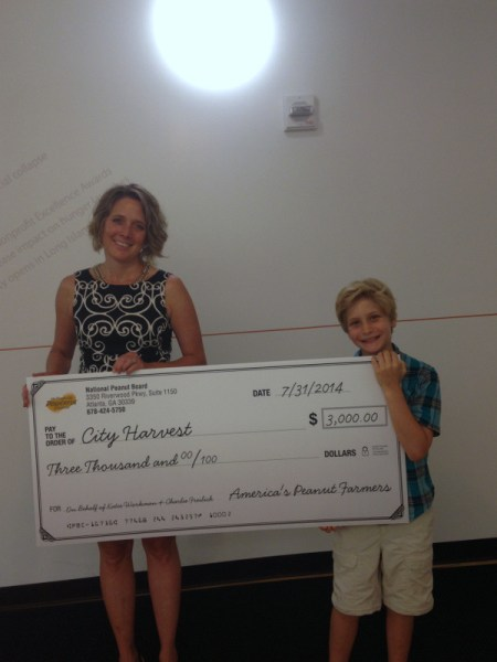 Charlie and Jen McClean of City Harvest accepting the check from the National Peanut Board
