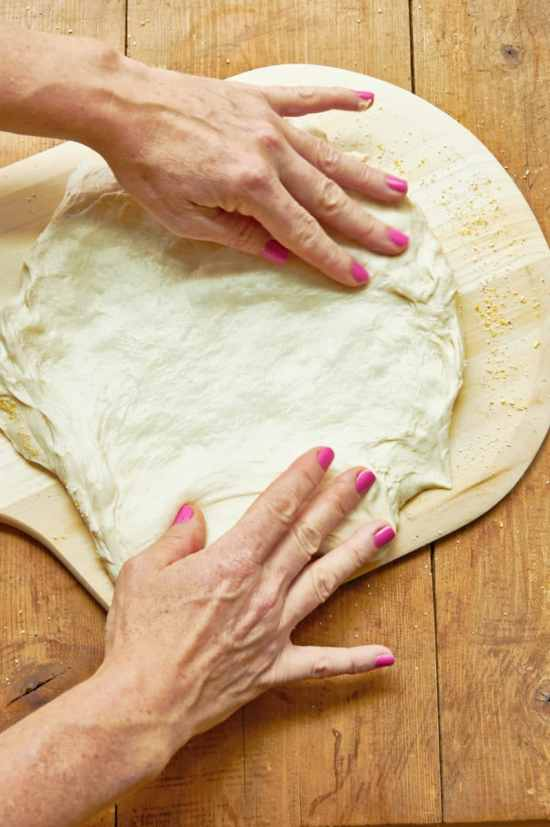 stretching pizza dough