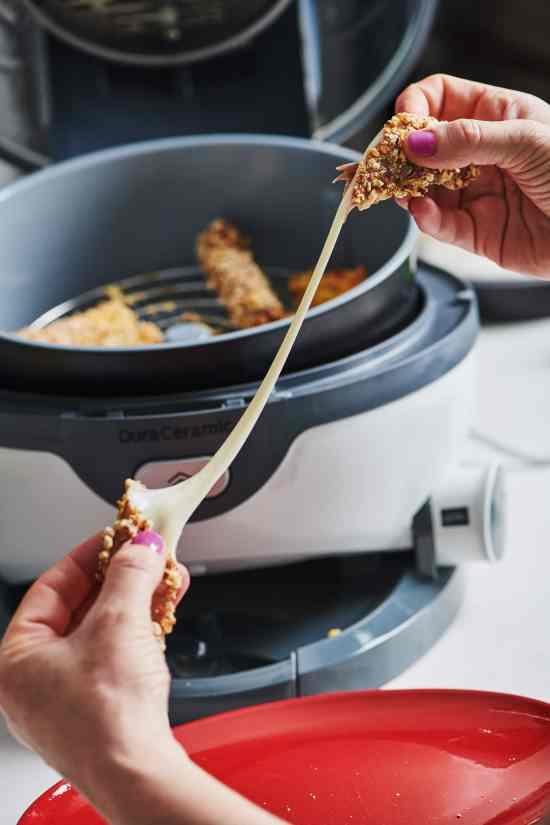 Pulling apart hot Air Fryer Mozzarella Cheese Sticks