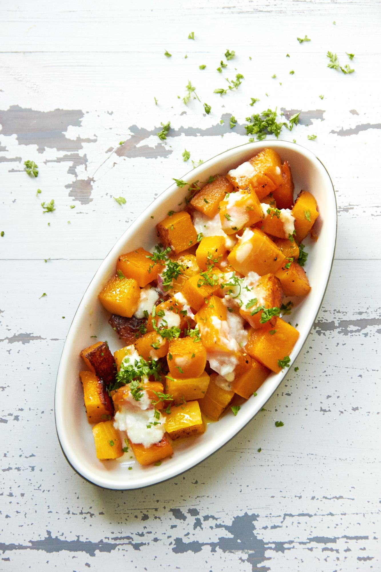 Roasted Butternut Squash with Creamy Sauce: A simple creamy dressing elevates a roasted butternut squash side dish with hardly any extra work.  Perfect for autumn or winter dinners and holiday menus! #sidedish #fall #thanksgiving
