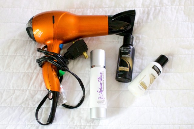 Hairdryer, brush and toiletries