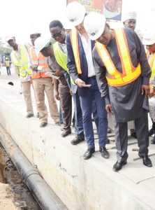 L-R:  Group Managing Director, Flour Mills of Nigeria Plc, Paul Gbededo; President/CE, Dangote Industries Limited, Aliko Dangote; and Managing Director, AG-Dangote Construction Company Limited, on the road inspection of Apapa-Wharf Road under construction by AG-Dangote Construction Company on Wednesday