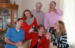Learn in Loss- Heather and 3 siblings with grandparents making silly faces