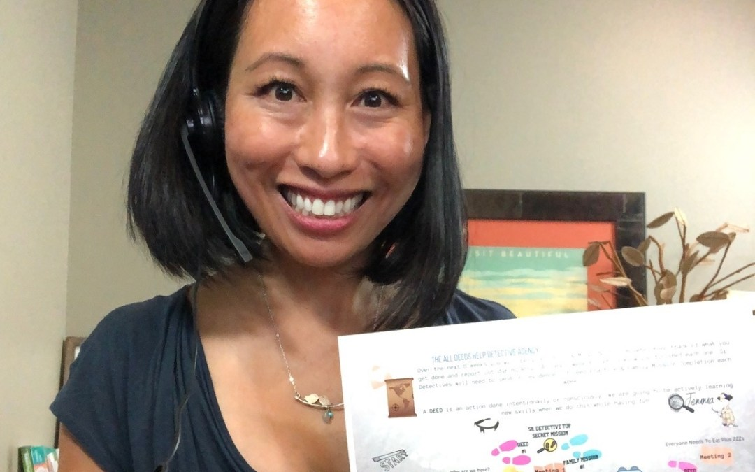 Woman, Mother, Behavioral Pediatric Doctor- Dr. Nerissa holding up a mission sheet for kids on their next adventure