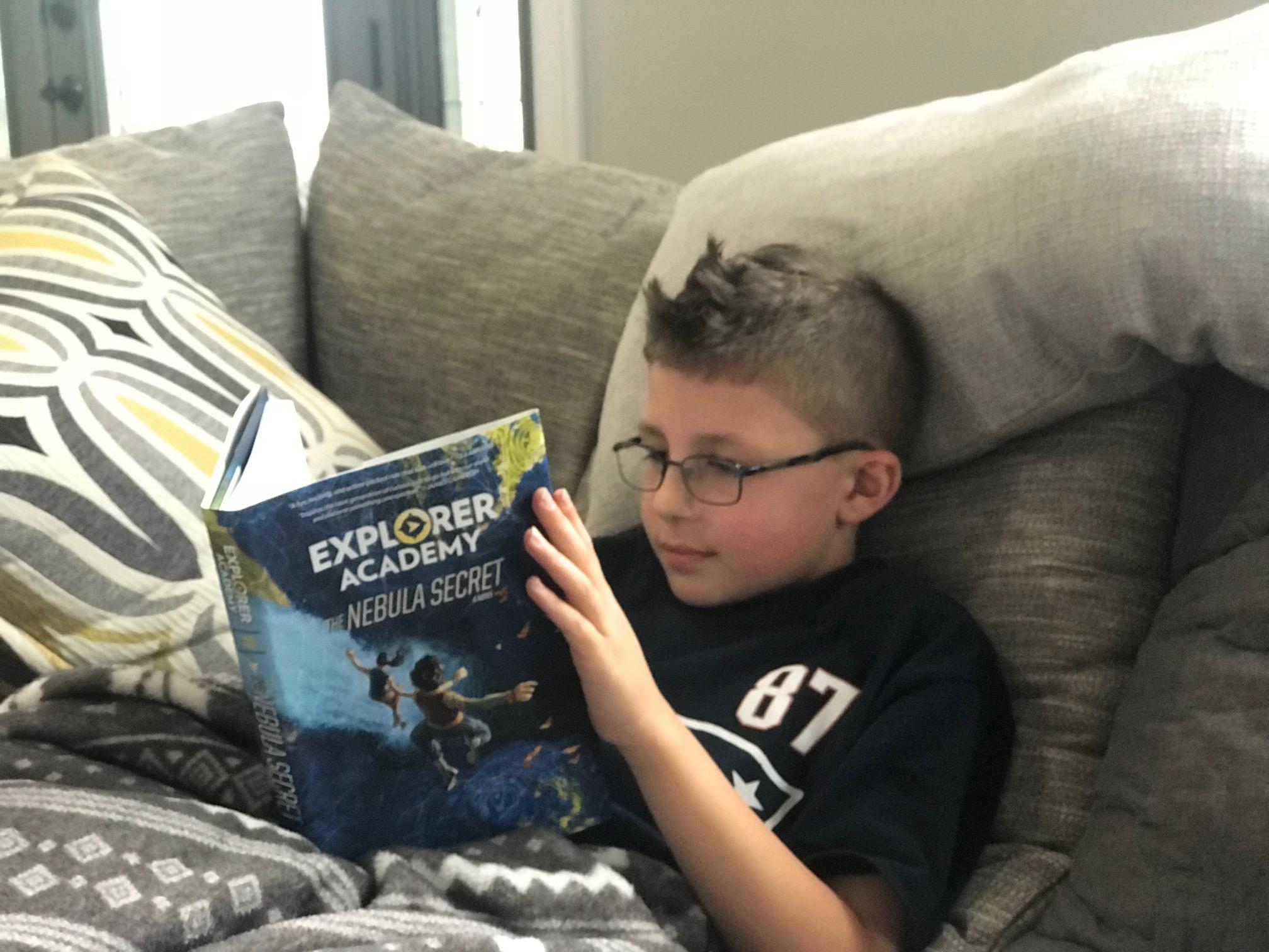 Boy Reading Explorer Academy Nebula Secret