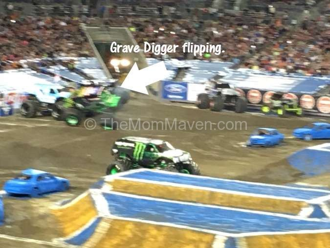 Grave Digger flipping while Monster Energy wins the race at Monster Jam