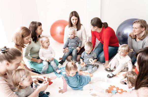 Mom group with toddlers at mommy and me class having fun