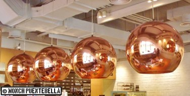 Overhead lamps in copper finish.