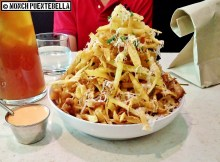 Pork and Potato Strips (P389): Pork belly pieces and potato strips, topped with herbs and cheese.