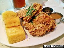 Buttermilk Fried Chicken (P559): Fried chicken fillet with Cajun spices served with honey glazed cornbread, accompanied with country gravy and honey.