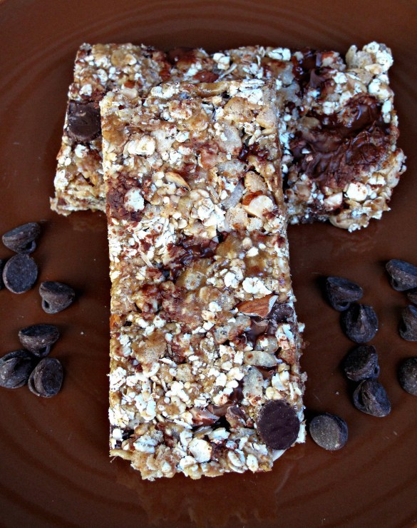 Granola bar on brown plate with chocolate chips