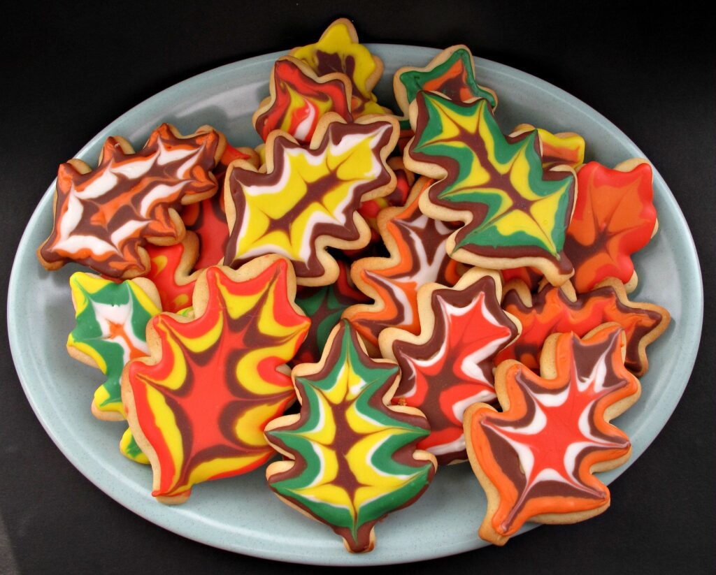Decorated Thanksgiving Sugar Cookies,iced like fall leaves on a platter.