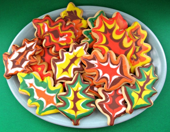 Decorated Thanksgiving Sugar Cookies on a platter with a green background.