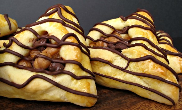 Hamantashen Pocket Cookies close up filled with chocolate and caramel