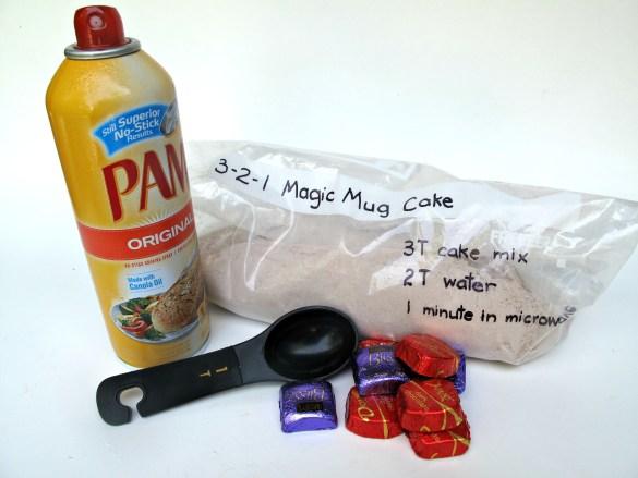 ingredients for 3-2-1 Molten Lava Mug Cake including Pam, chocolates, and mug cake mix