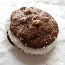 Passover Chocolate Coconut Whoopie Pies- ultra-chocolaty, chewy chocolate chip cookies sandwiched with marshmallow filling and dipped in shredded coconut. They happen to be kosher for Passover and gluten free. But no one would ever know. They are THAT good!  The Monday Box