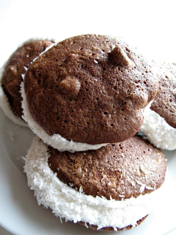 Passover Chocolate Coconut Whoopie Pies (Gluten Free) with marshmallow filling and edges rolled in coconut