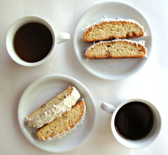 Coconut White Chocolate Biscotti and cups of coffee for dunking.