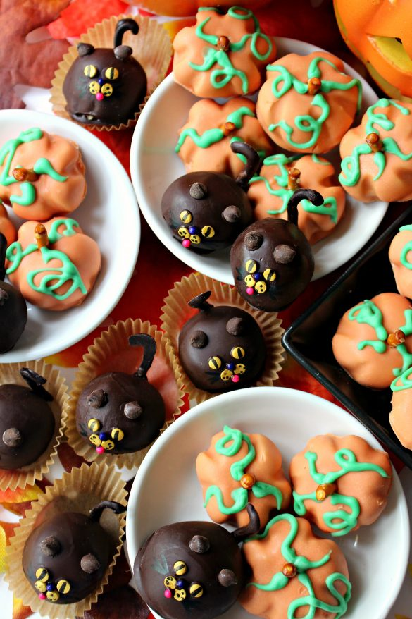 Peanut Butter Ball Pumpkins and Cats in little white bowls and in tan cupcake papers.