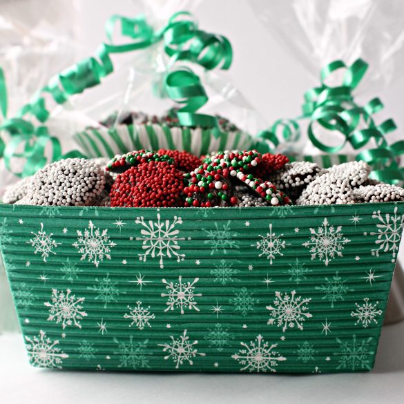 Nonpareil Candies in a green gift box with a snowflake pattern