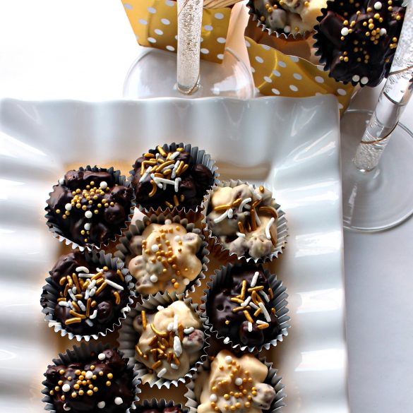 No Bake Chocolate Peanut Butter Cookies on platter with the stems of two champaign glasses visible