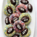 Shortbread Thumbprint Cookies with chocolate footballs on each cookie
