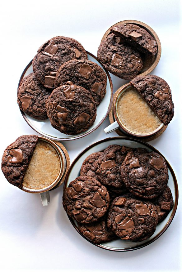 Chocolate Chip Mocha Cookies on plates with two cups of coffee