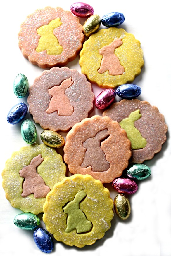 Scalloped edge circle shortbread with rabbit silhouette centers.