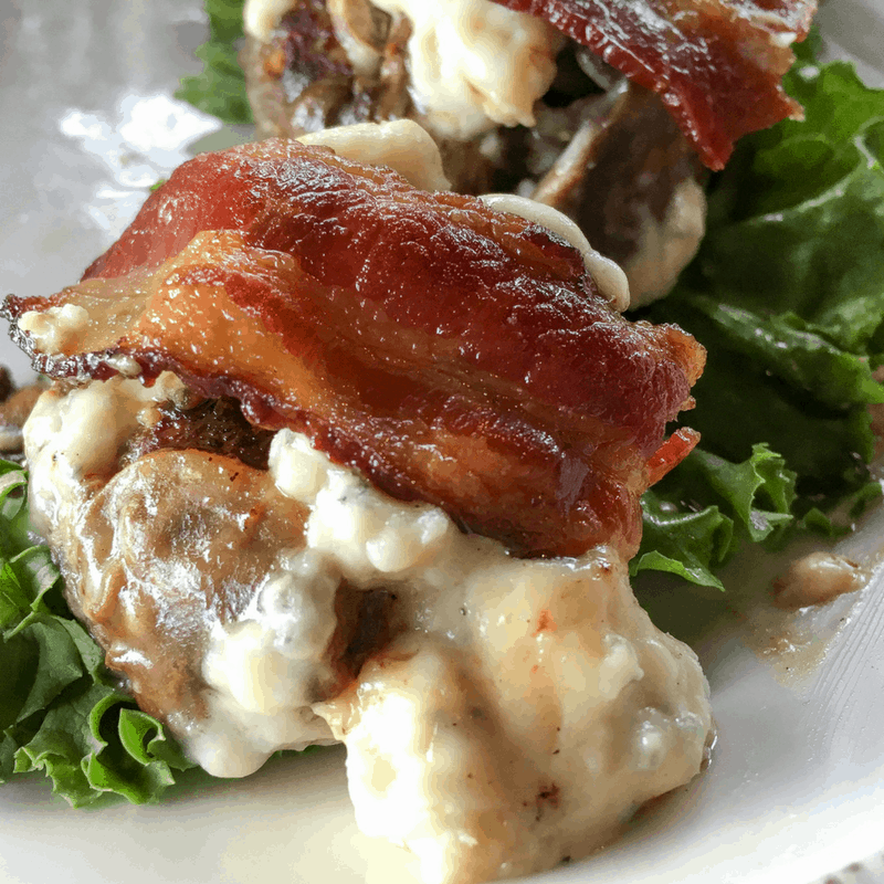 This delicious recipe features bacon, bleu cheese, blue cheese, mushroom sliders burgers on a bed of lettuce.