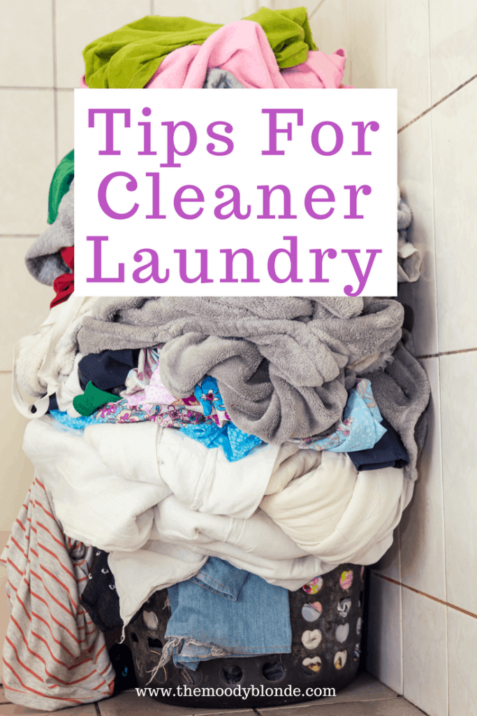 tips for cleaner laundry basket overflowing with dirty laundry clothes