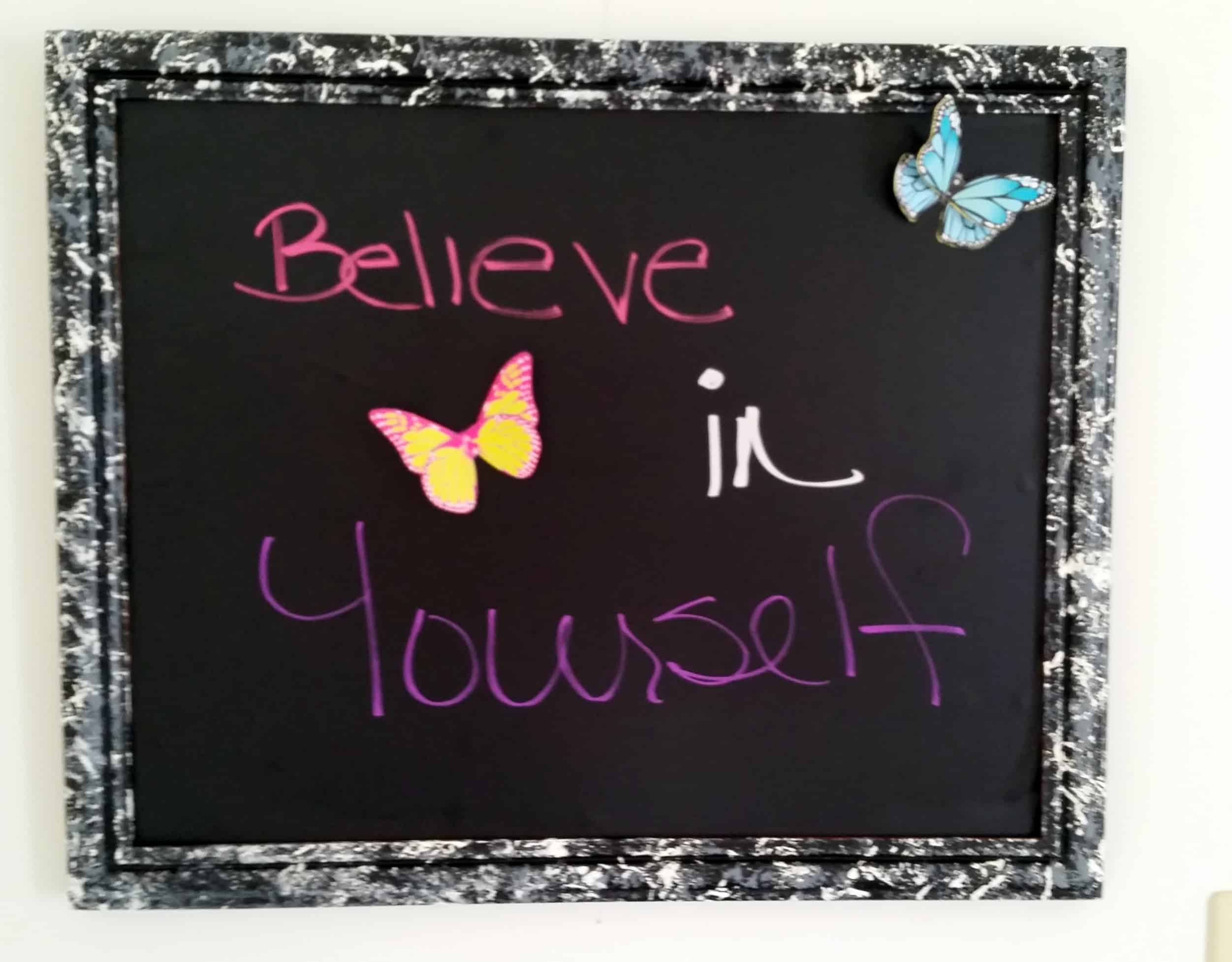 photo of how to upcycle a photo collage frame with marbled background and the words believe in yourself written on it with butterflies