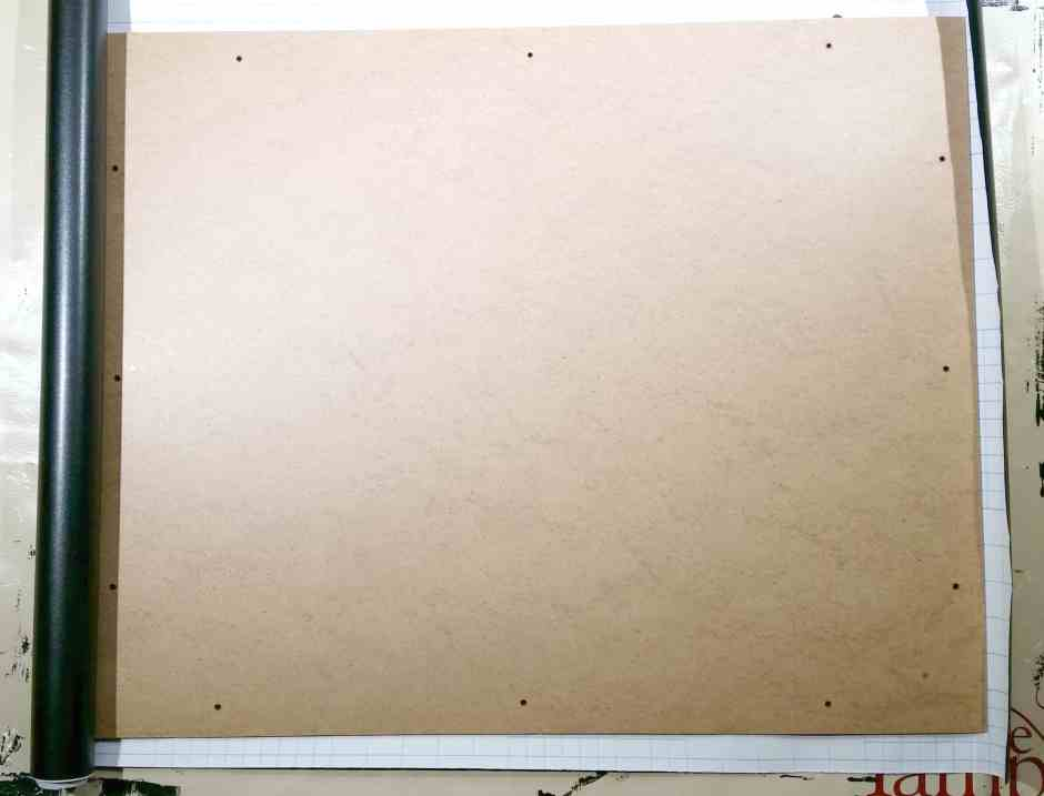 photo of how to upcycle a photo collage frame with pressboard insert having chalkboard paper put on it.
