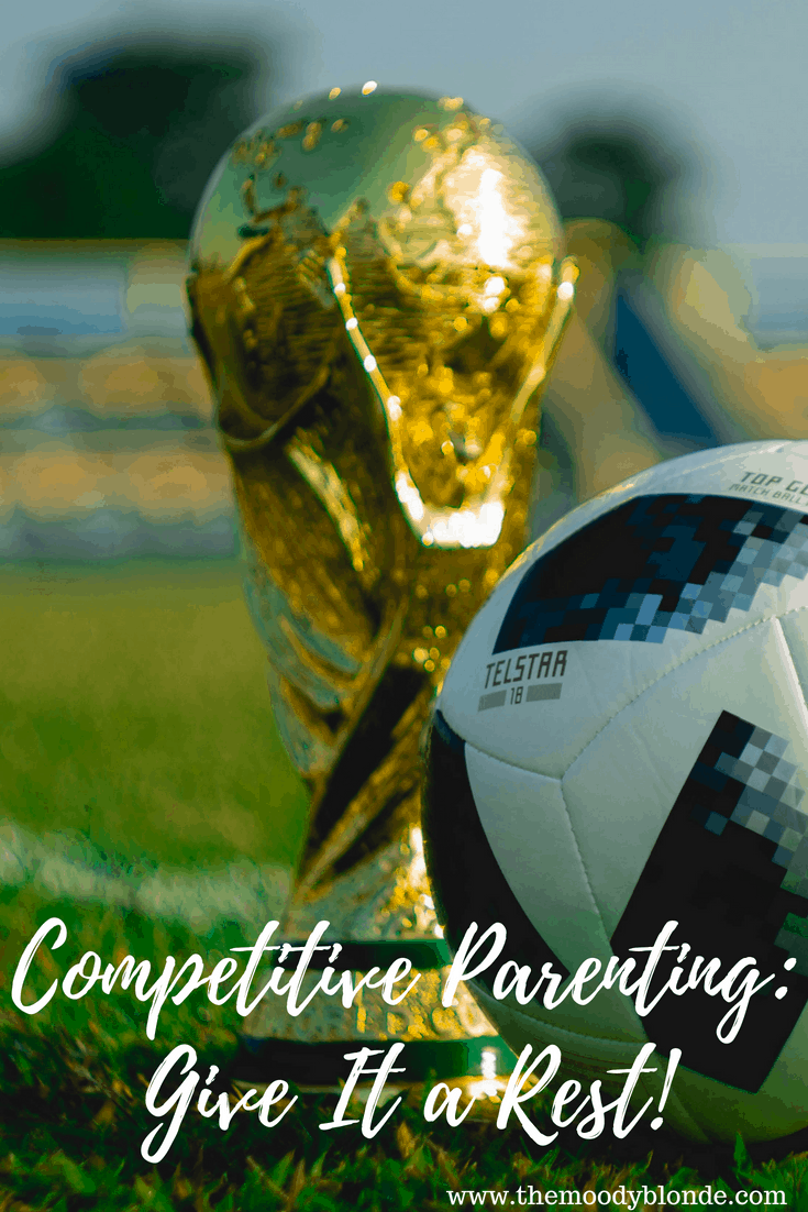 "gold soccer trophy and soccer ball on green grass ; text says ""Competitive Parenting: Give It A Rest"""