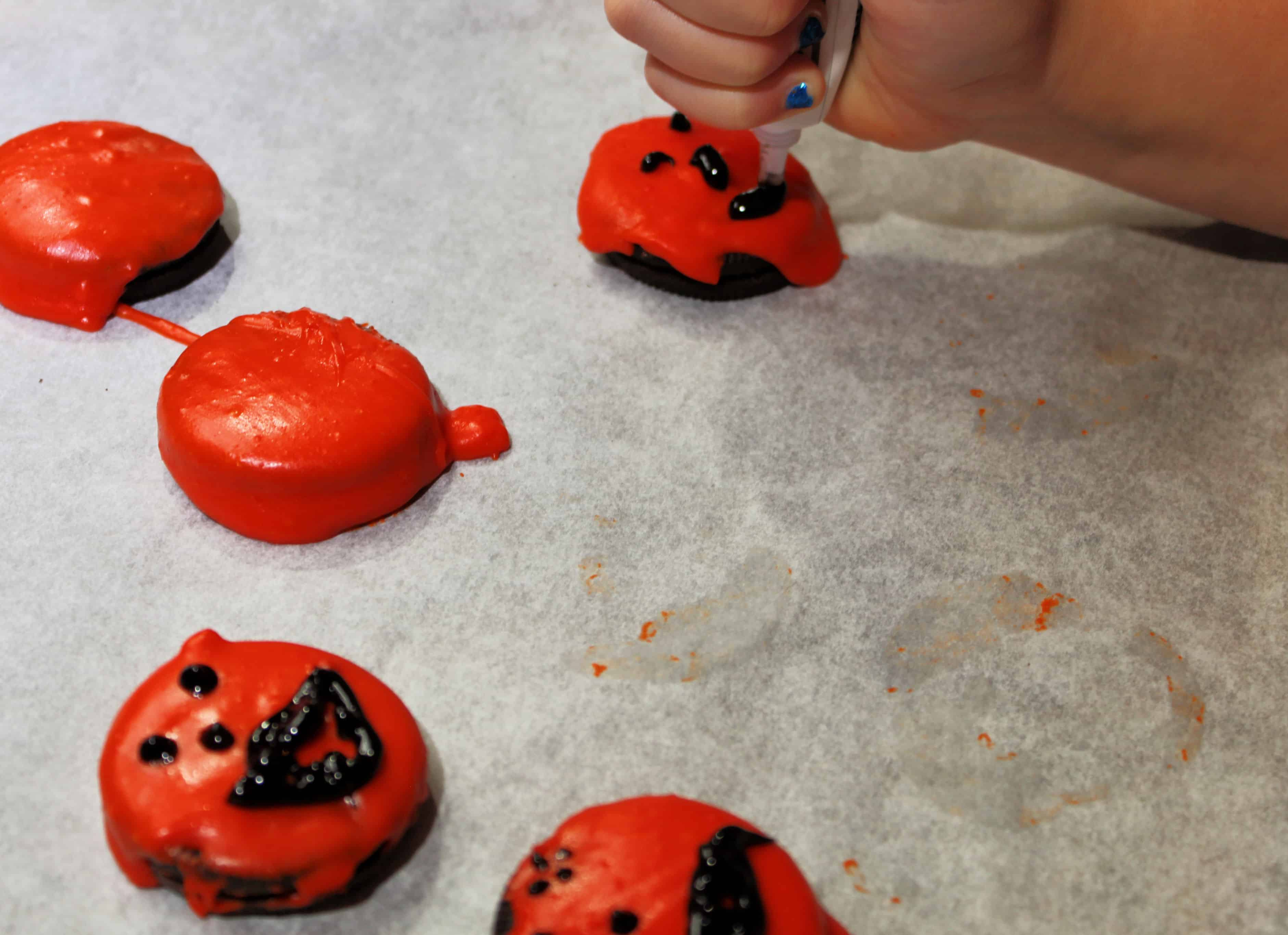Child Decorating Jack O' Lantern Oreos
