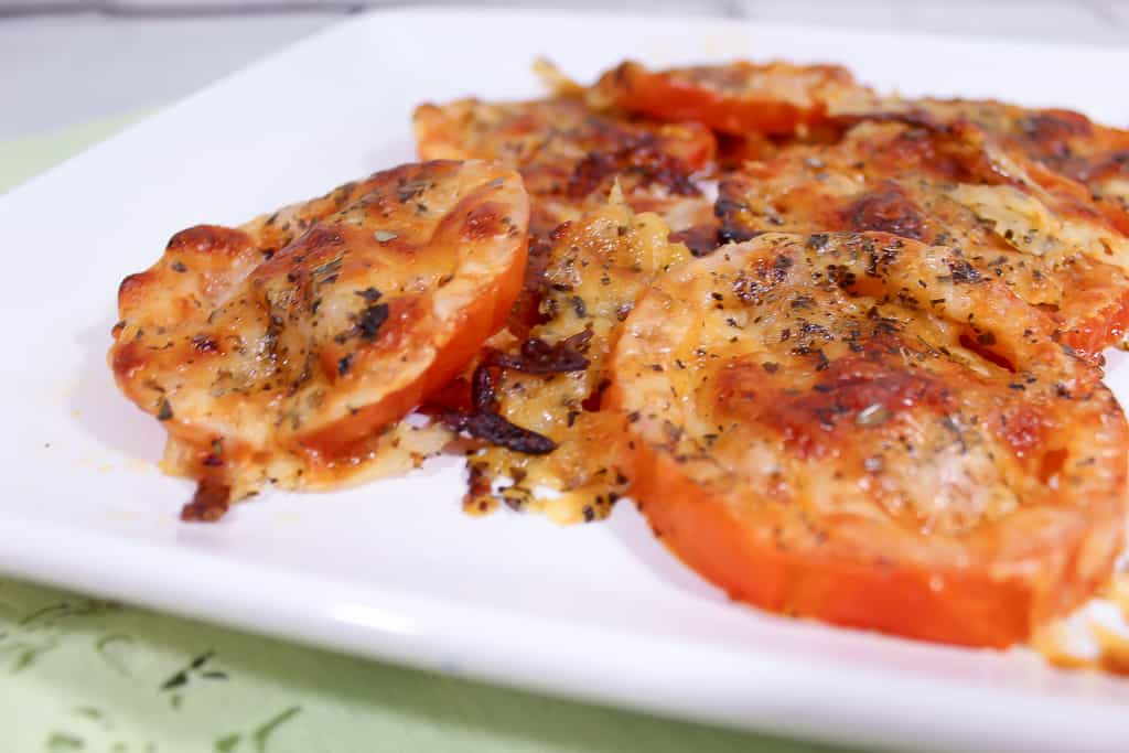 Close up of Keto Friendly Italian Tomato Pizza Bites Recipe served on a white plate.