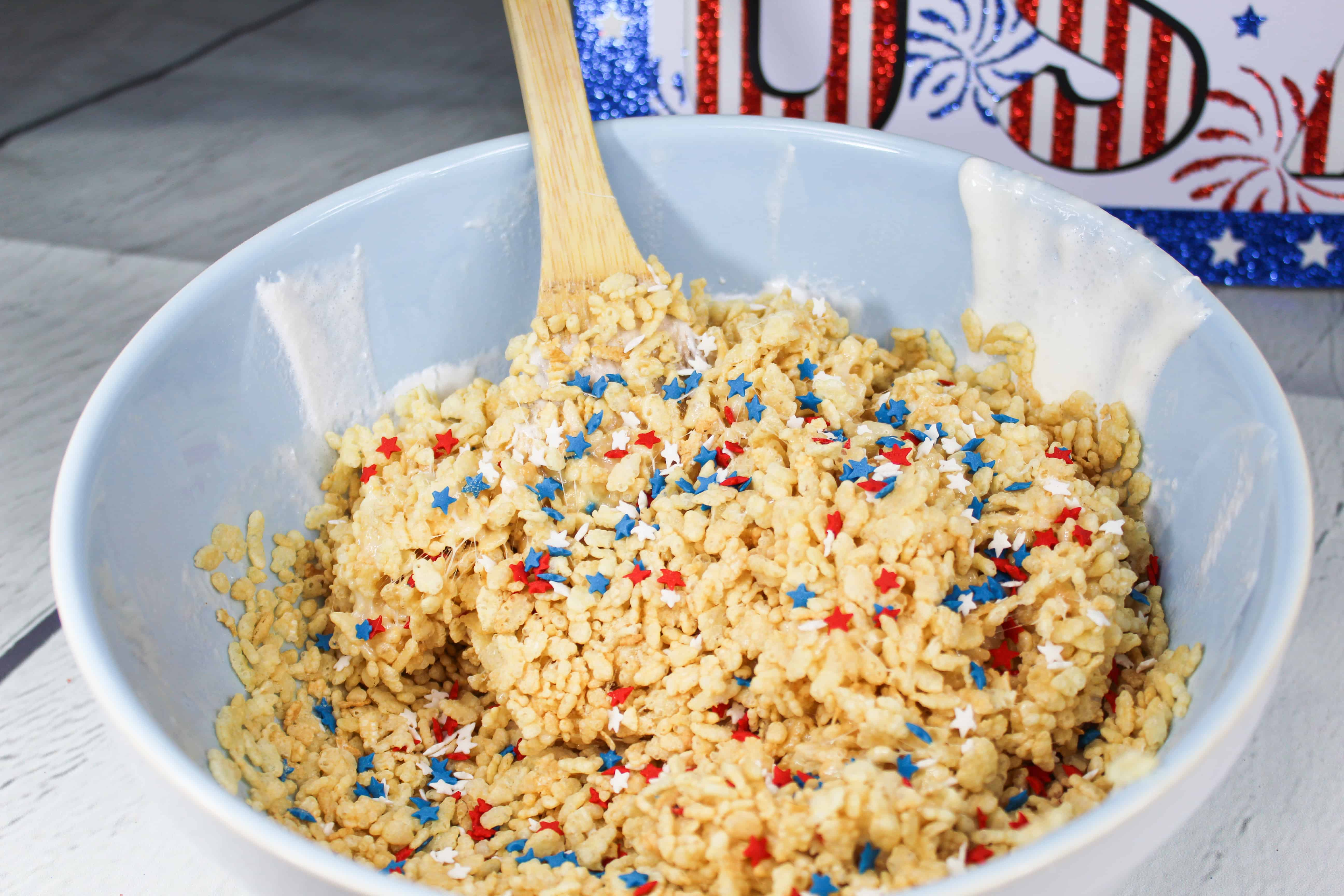 Stir star sprinkles into delicious red white and blue rice krispie treat batter